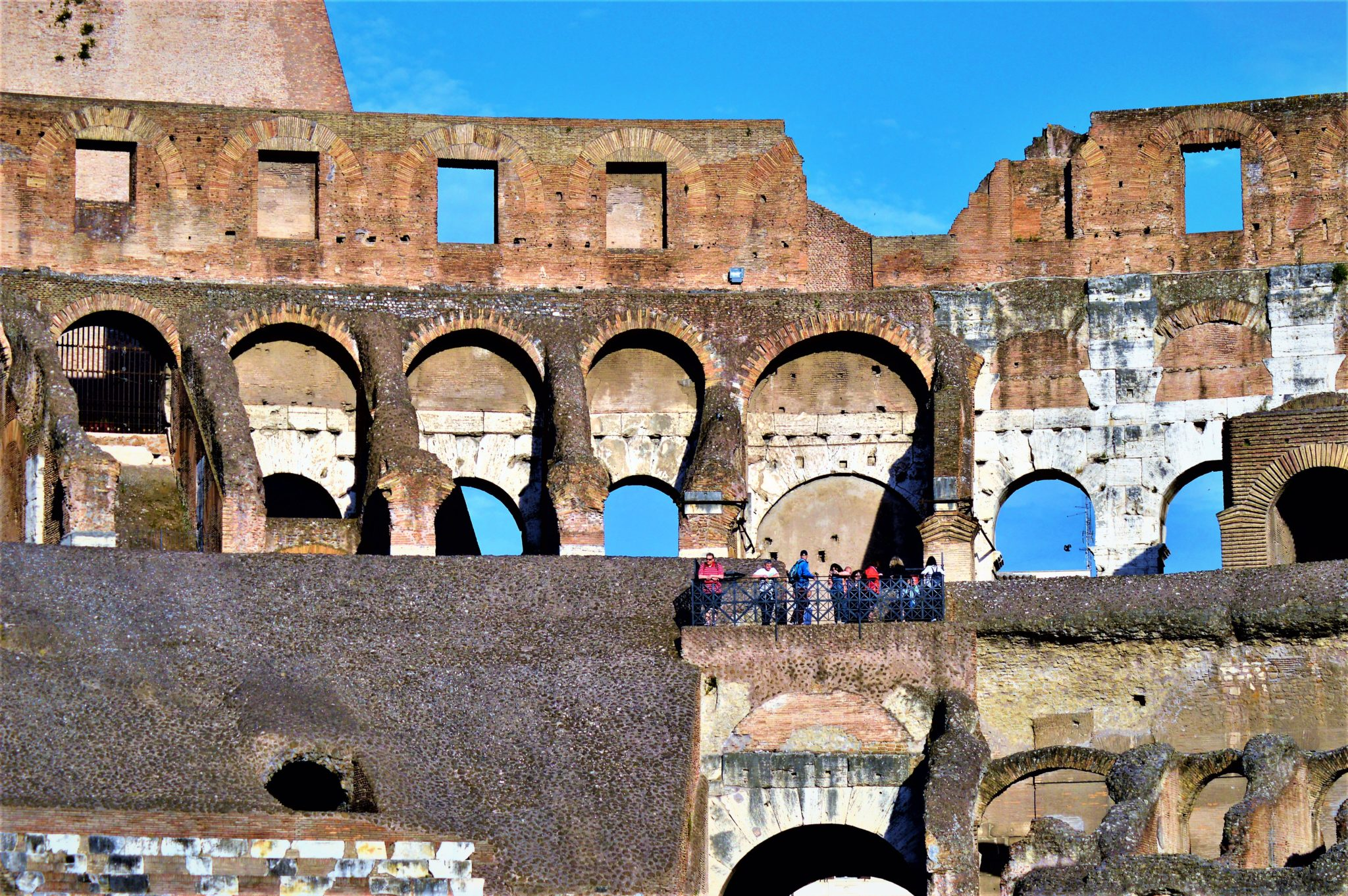 Tourists inside the Roman Colosseum, Rome, Italy