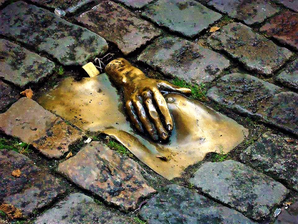 Boob statue in pavement, Amsterdam, Holland
