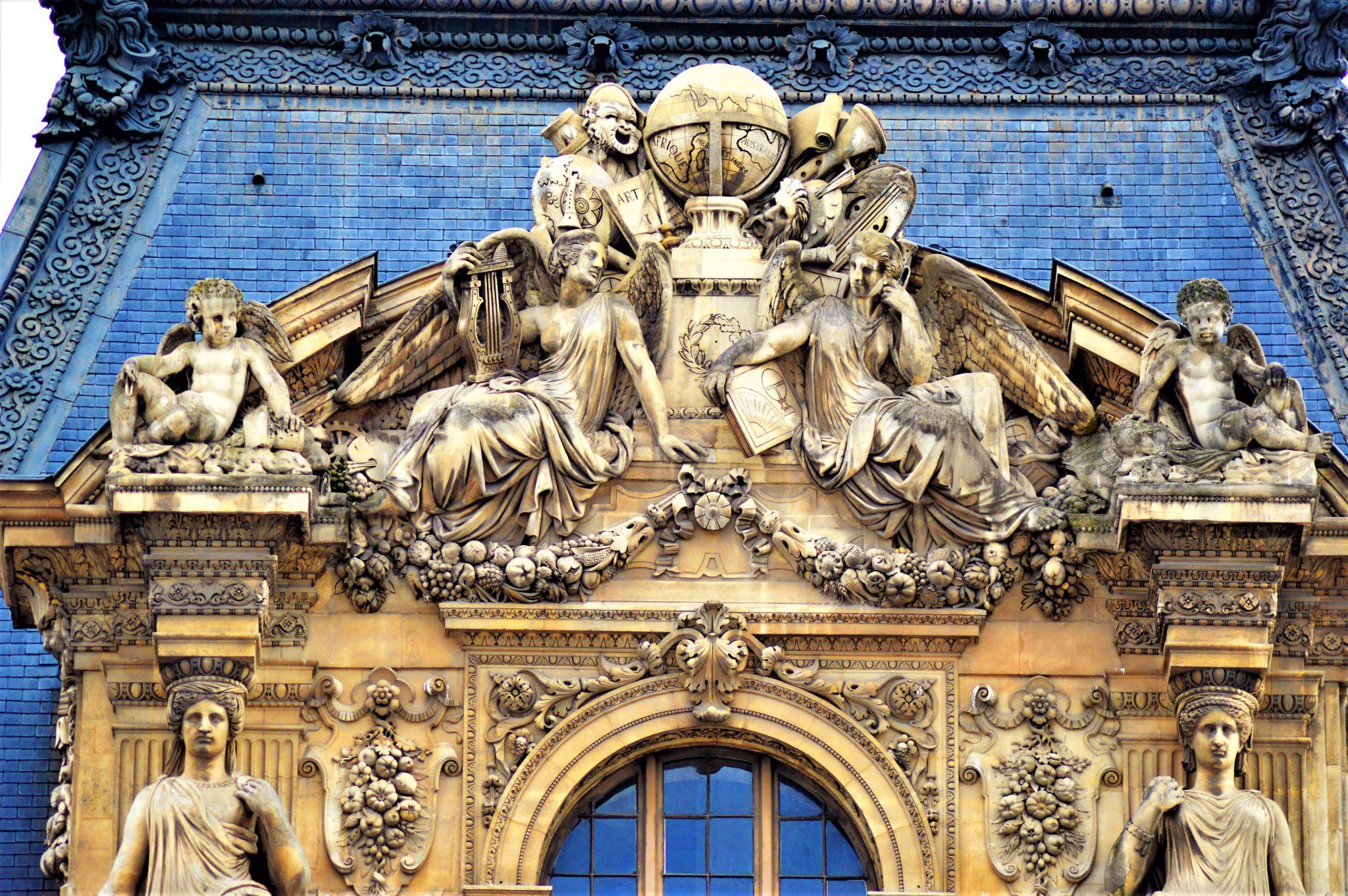 Sculptures on buildings near Louvre, Paris