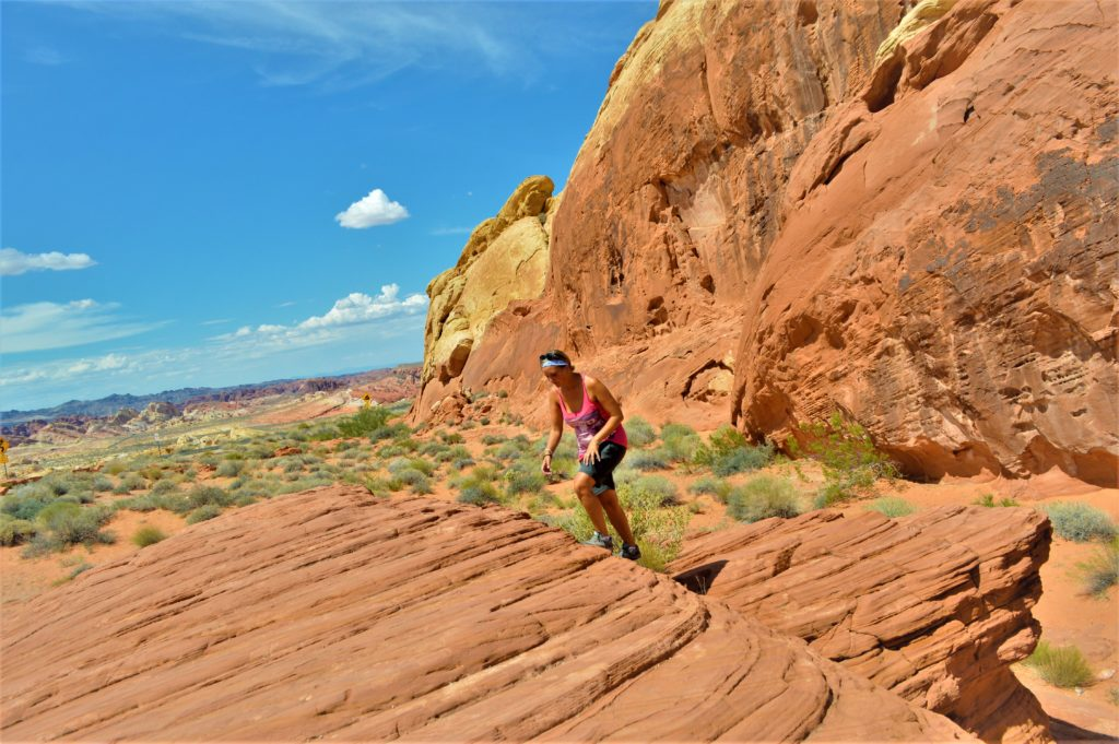 Climbing rocks at the valley of fire state park, utah