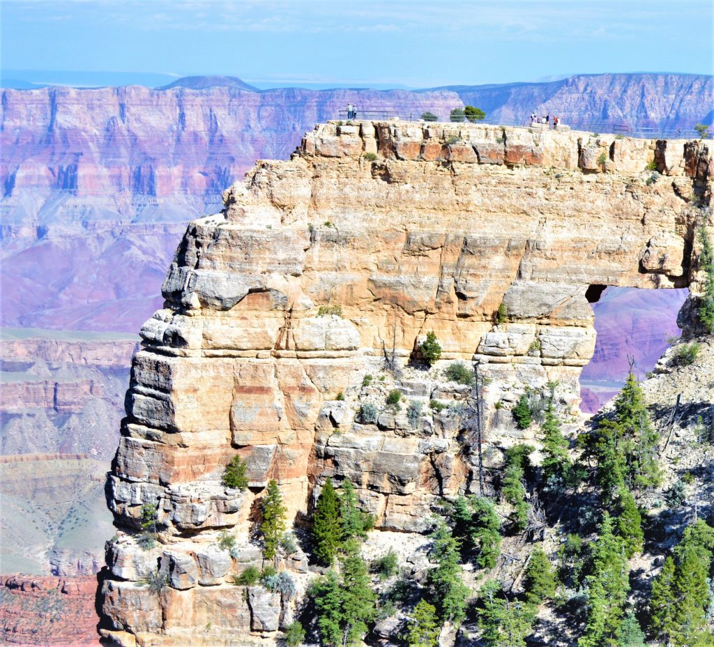 People walking on Angel's Window, Grand Canyon North Rim
