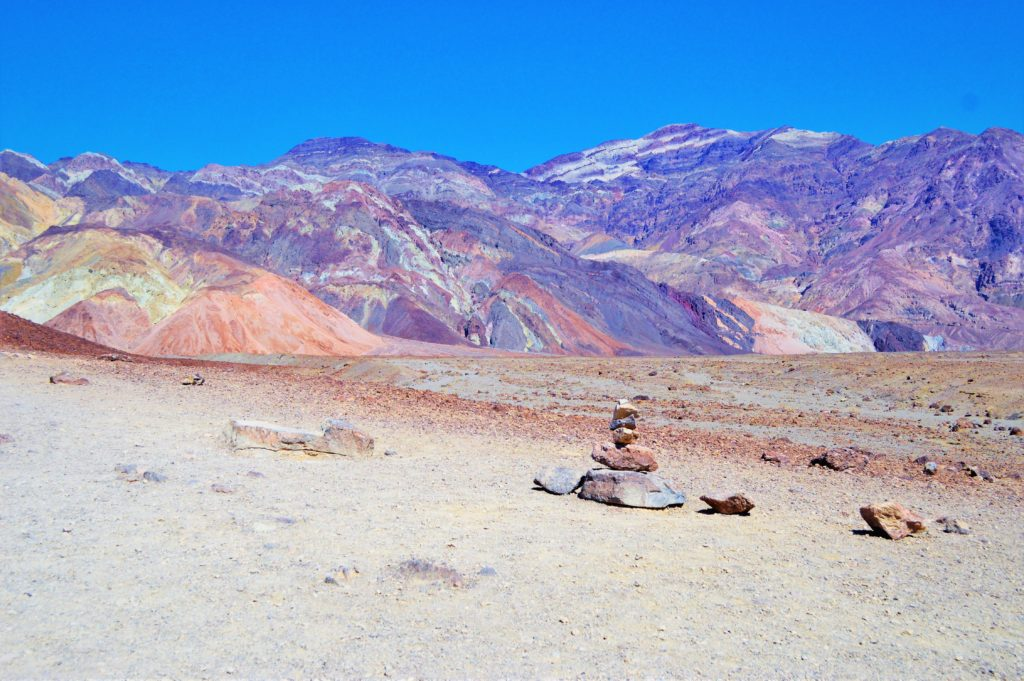 Stacked rocks in death valley artist paint pots, USA