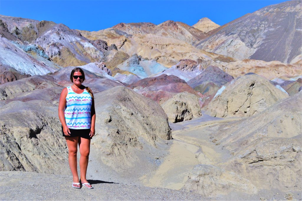 Standing by the pain pots, death valley national park, usa