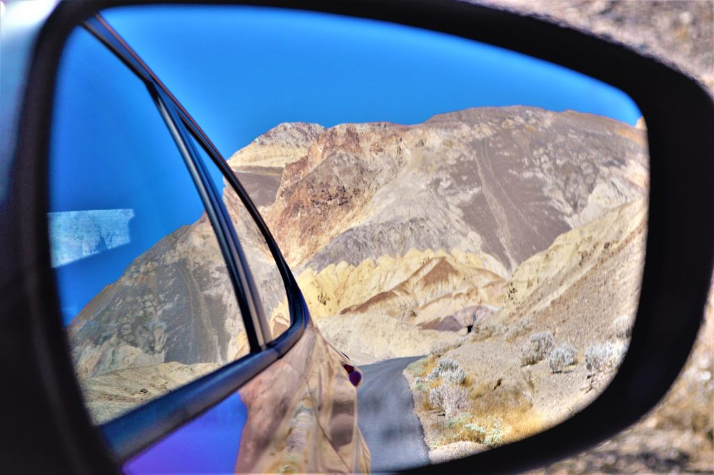 Wing mirror view or death valley paint pots, usa