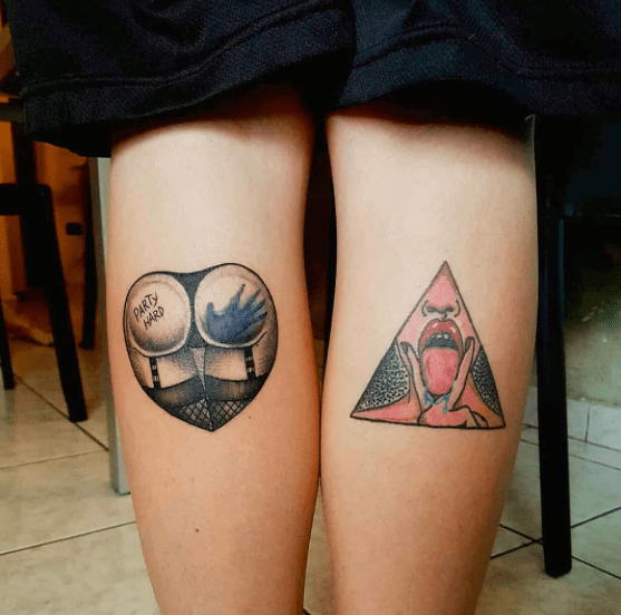 Tattooed lesbians having fun together
