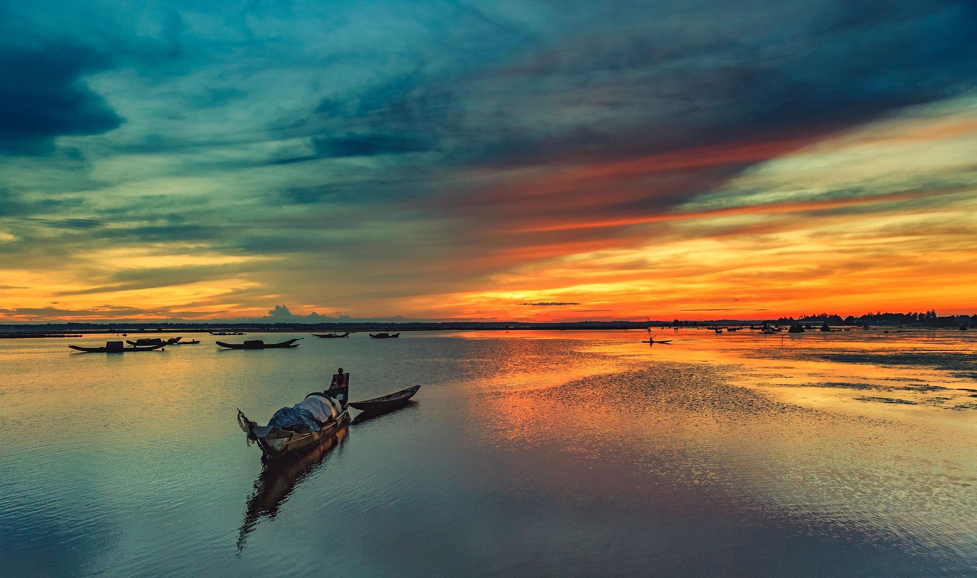 Hue, fishing boat in lake at sunset, Vietnam