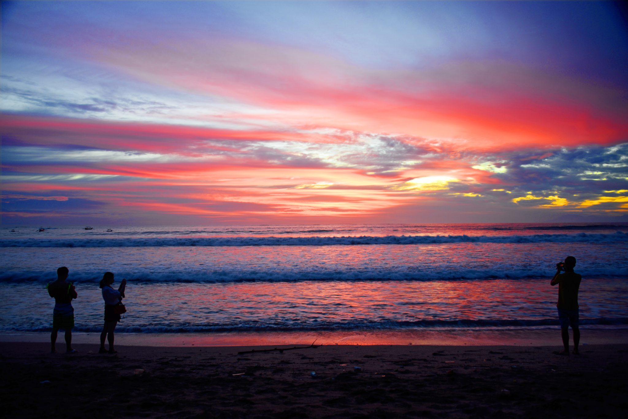 flights to Australia - Top layover destinations Bali Sun set on beach